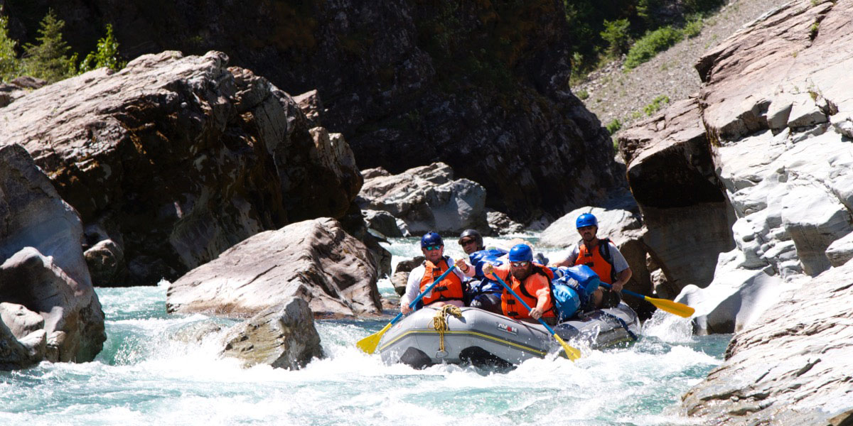raft coming through whitewater rapids